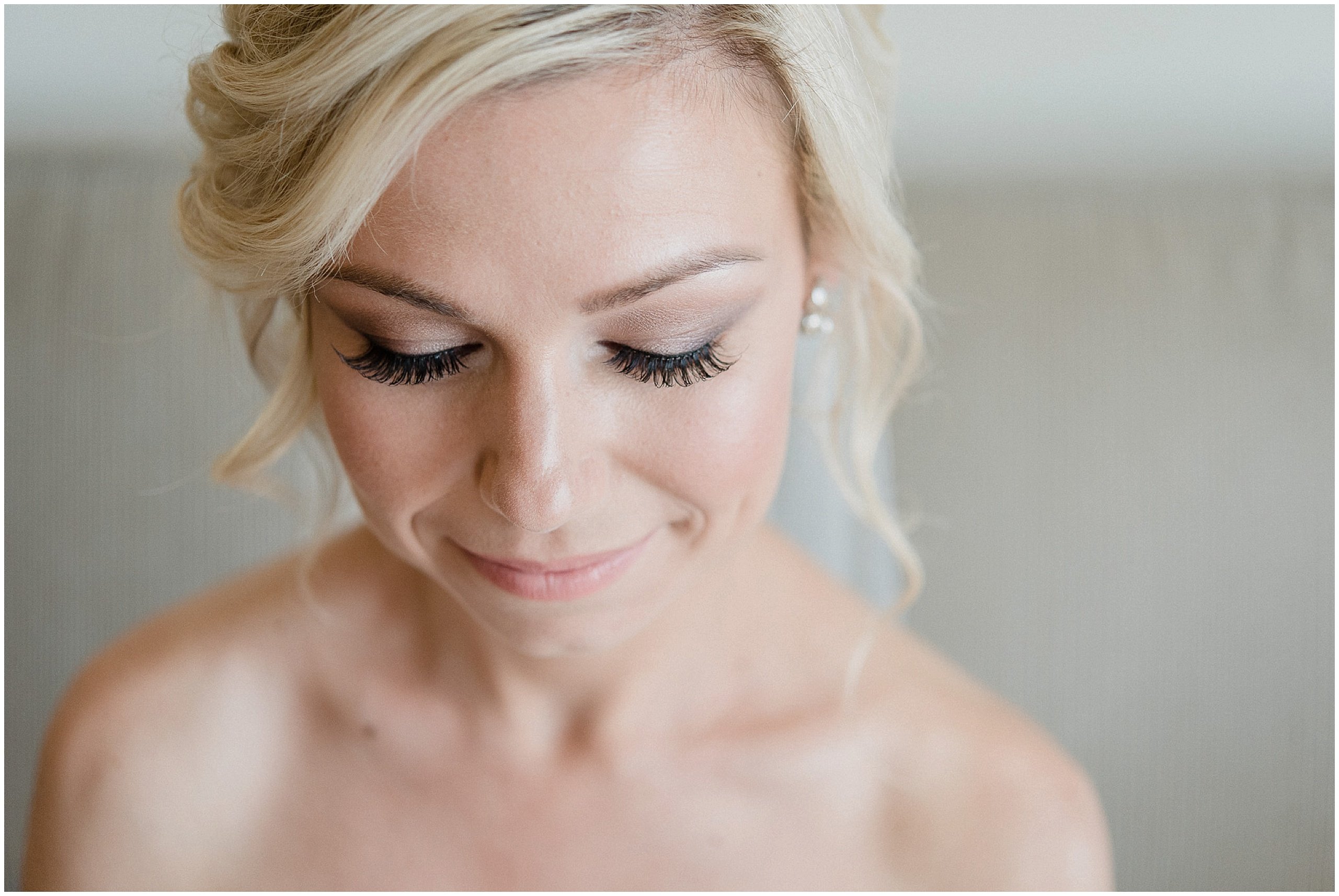 Bridal portrait with long lashes. Makeup by Presley Foskett, photographed by Jenn Kavanagh Photography