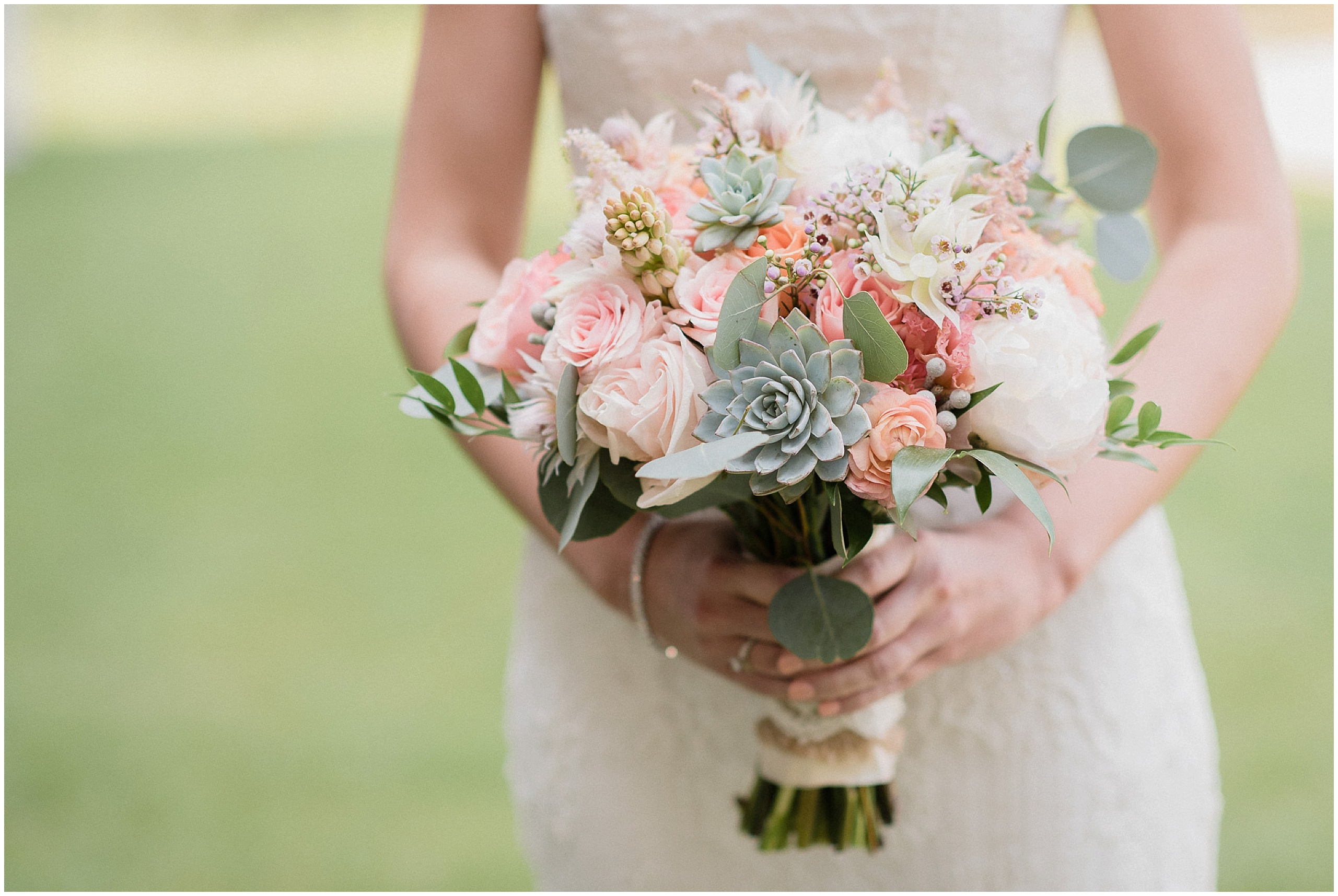 Bride's bouquet with succulents, garden roses, and peonies. Photographed by Jenn Kavanagh Photography
