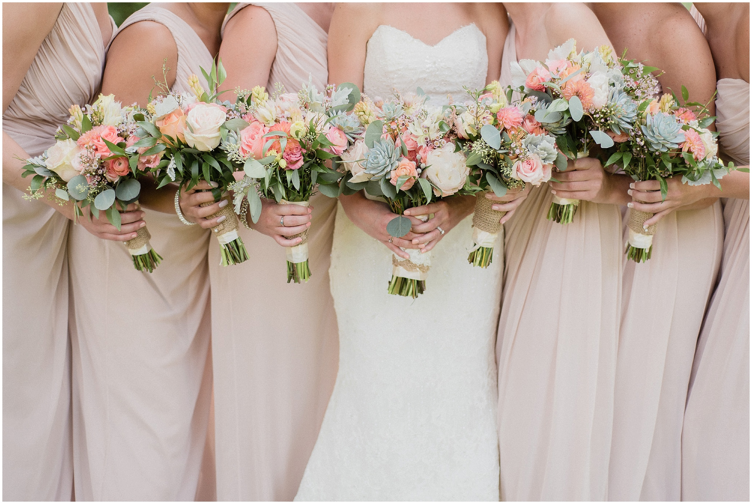 Bridesmaids bouquets with succulents, garden roses, and peonies. Photographed by Jenn Kavanagh Photography