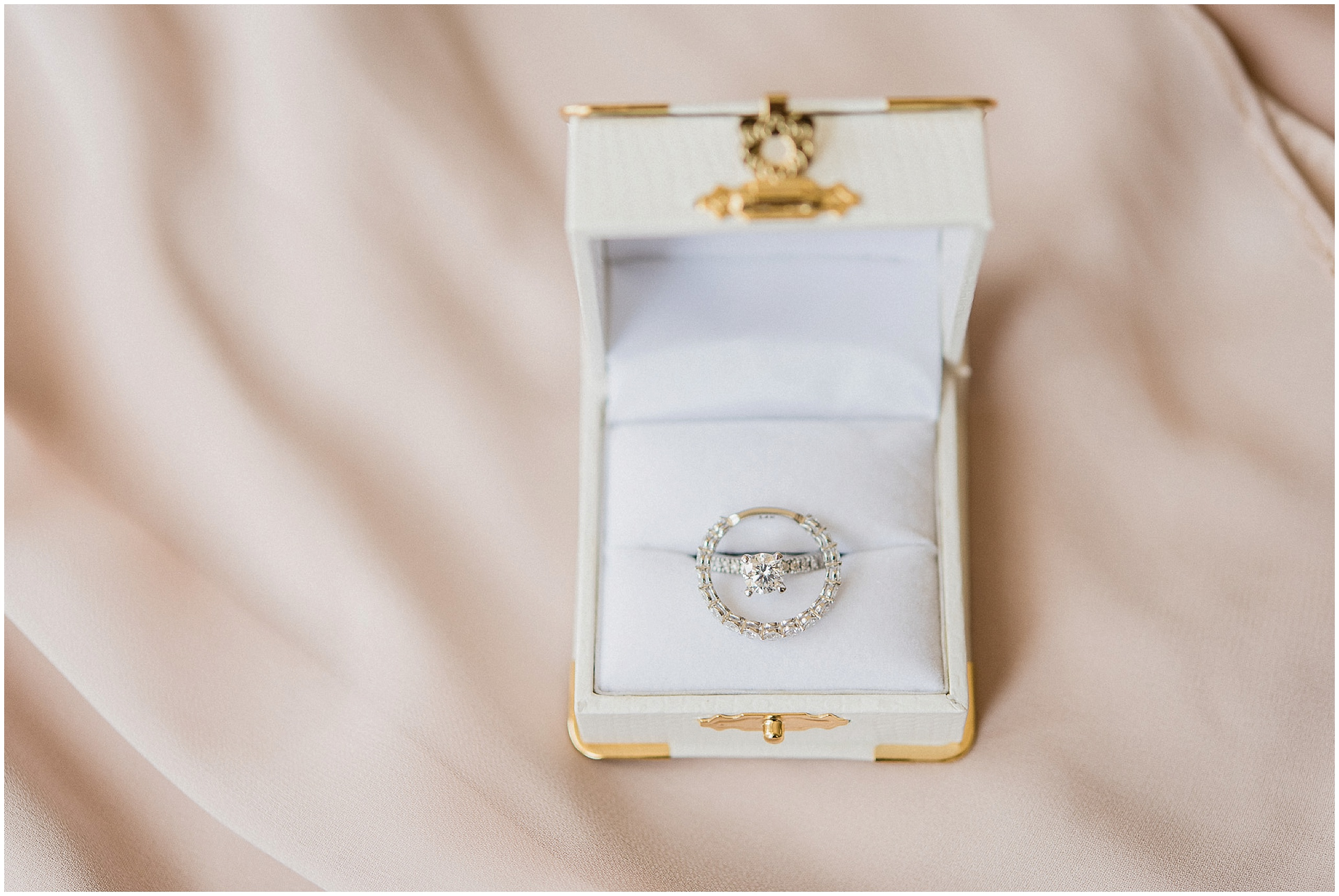 White gold engagement ring and wedding band in white ring box. Photographed by Jenn Kavanagh Photography
