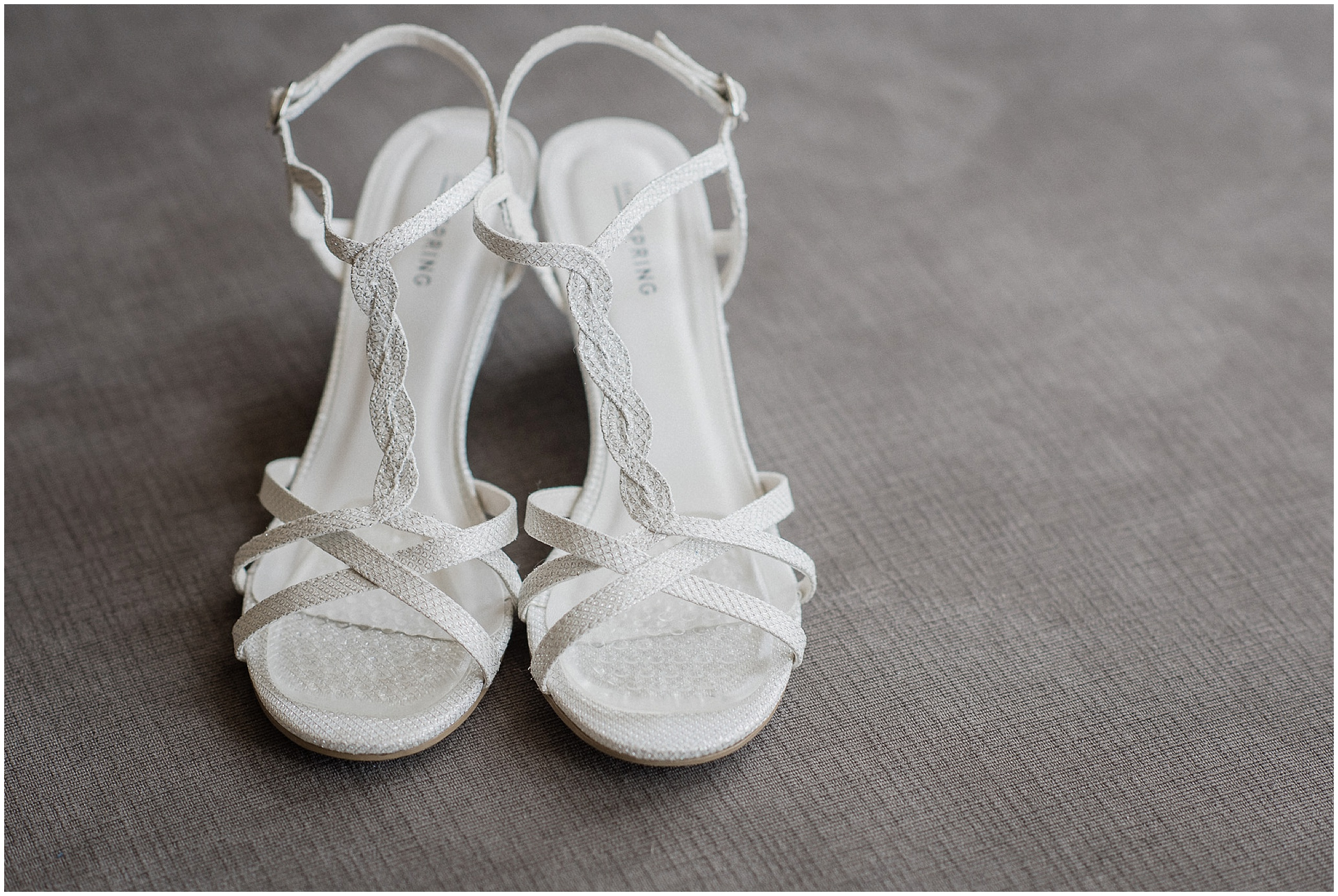 White bridal wedges by Spring, photographed by Jenn Kavanagh Photography