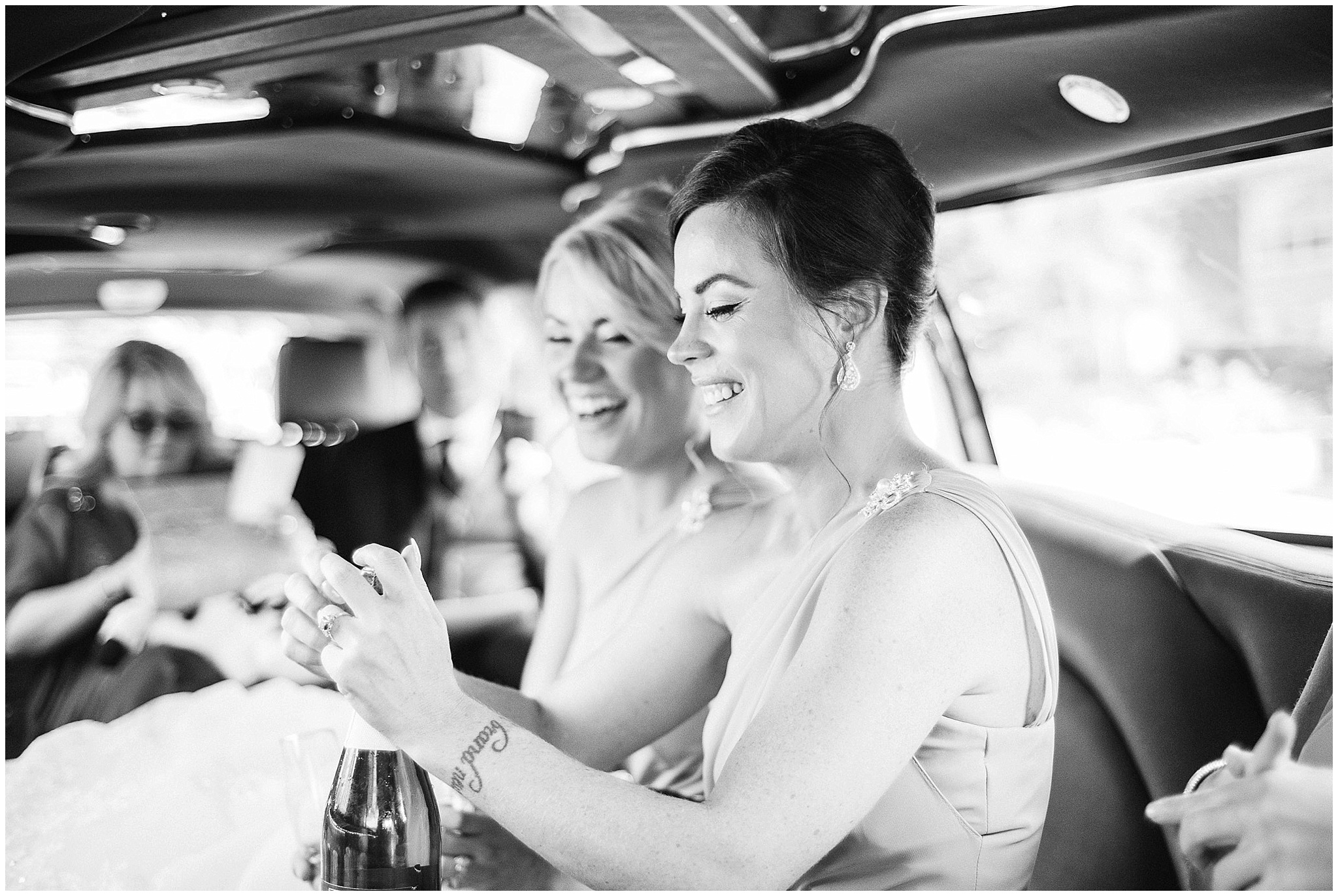 Bridesmaids popping champagne photographed by Jenn Kavanagh Photography