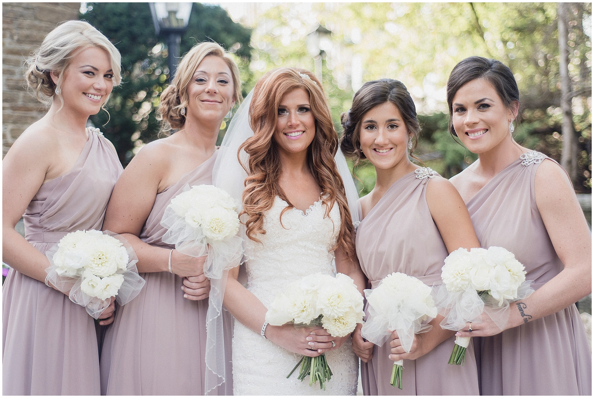 Dusty rose bridesmaids dresses photographed by Jenn Kavanagh Photography