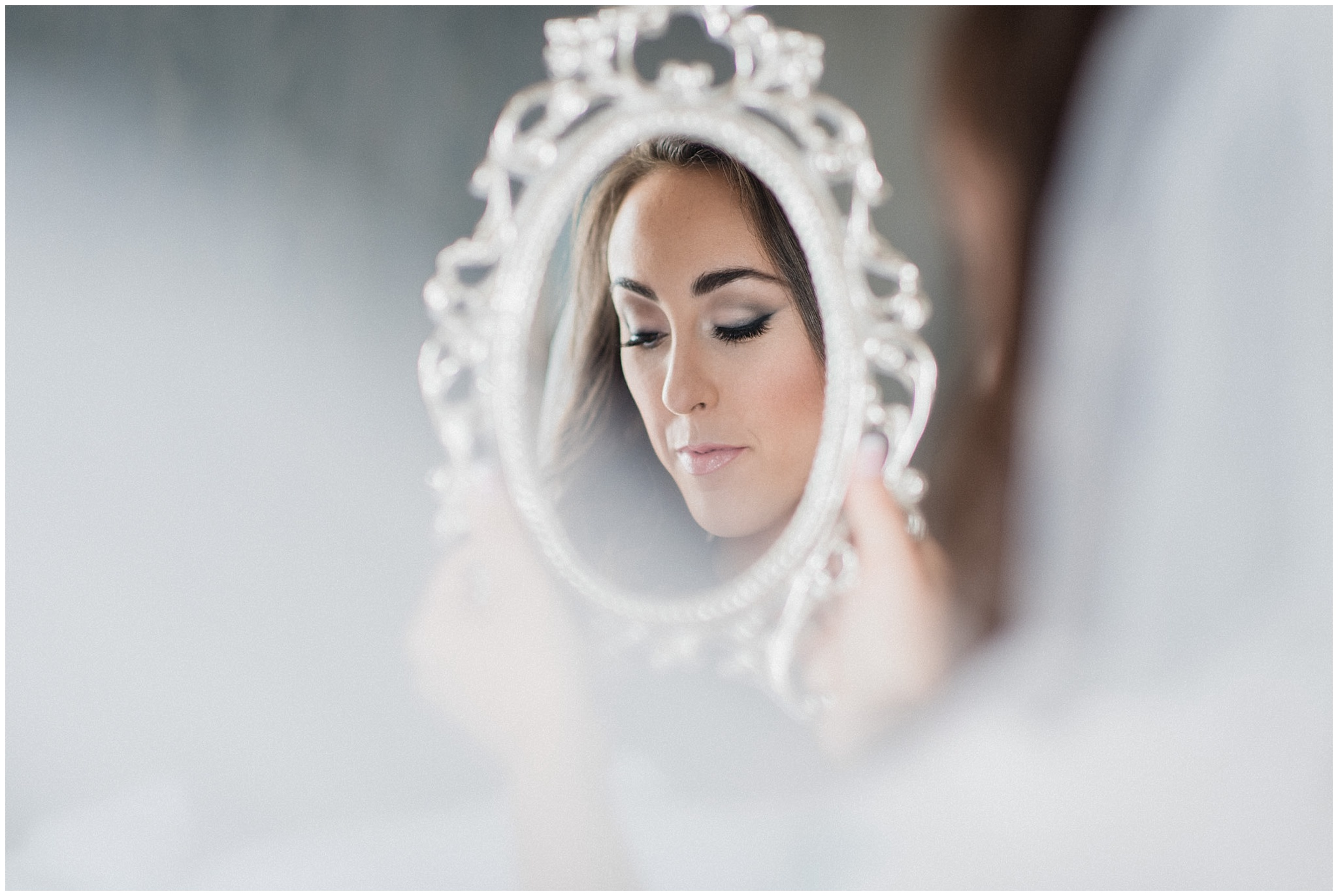 Beautiful bride looking into antique mirror | Distillery District wedding by Jenn Kavanagh Photography