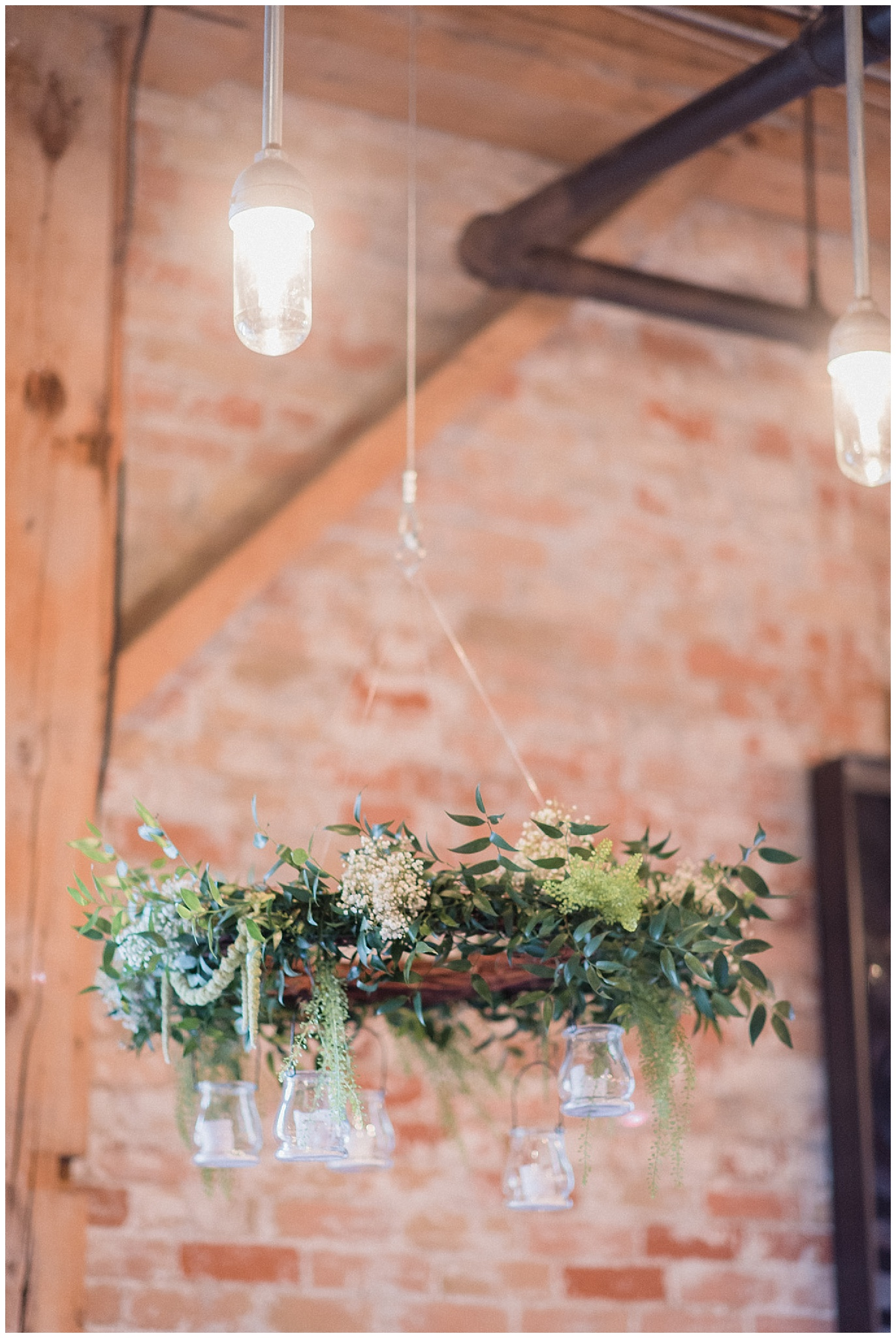 Floral wreath chandeliers, Archeo | Distillery District wedding by Jenn Kavanagh Photography