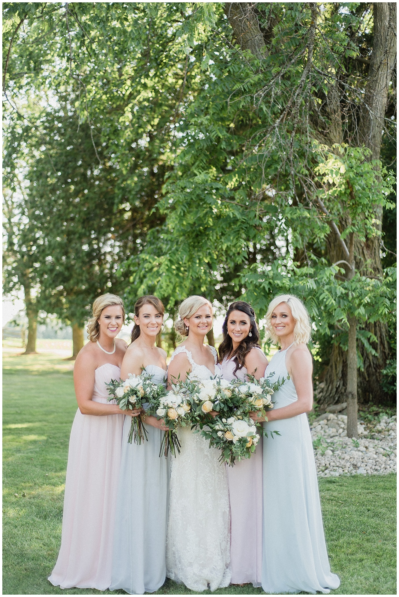 Mismatched pastel Amsale bridesmaids dresses | Tent wedding on family farm in Guelph, Ontario by Jenn Kavanagh Photography
