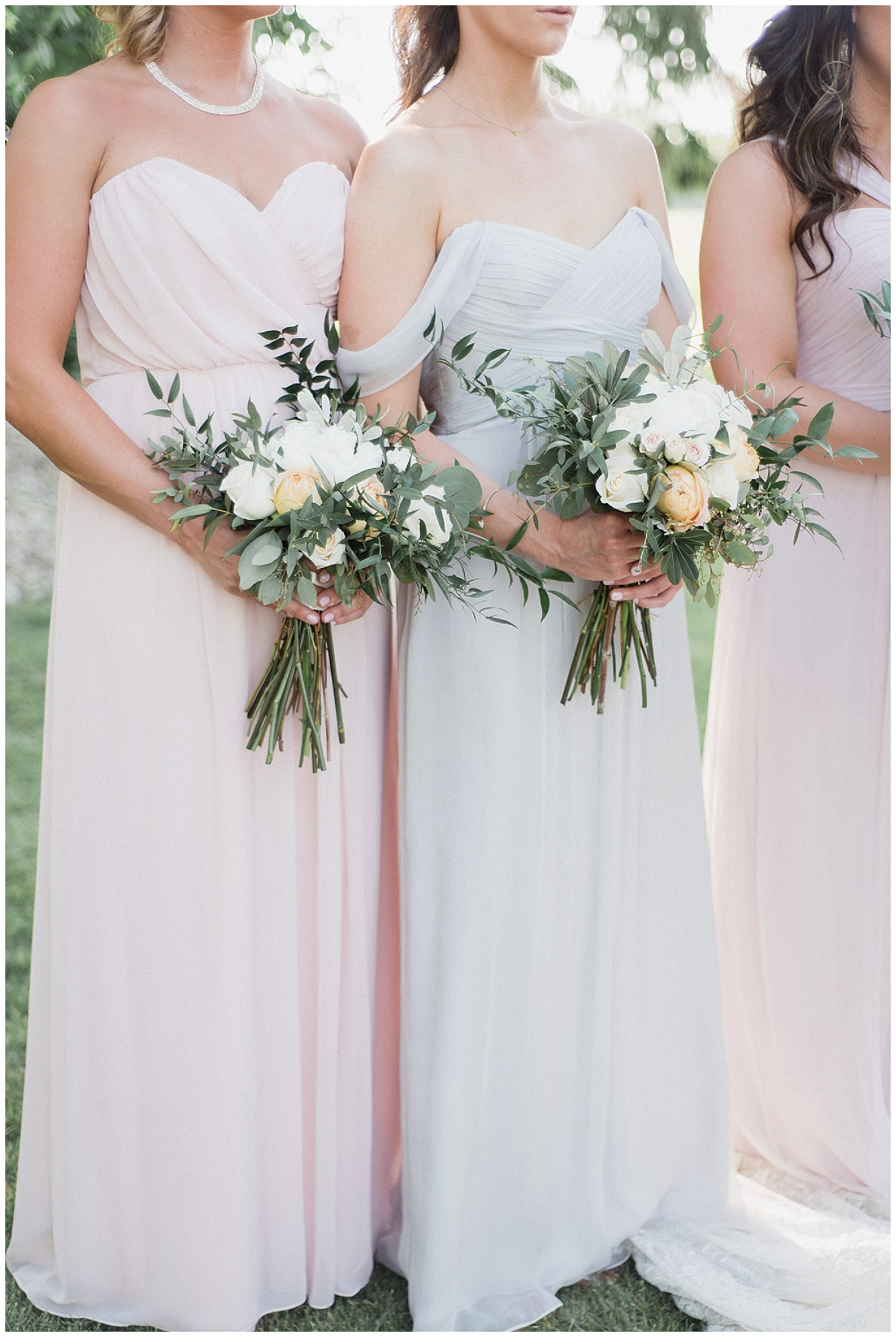 Mismatched pastel Amsale bridesmaids dresses with hand tied bouquets | Tent wedding on family farm in Guelph, Ontario by Jenn Kavanagh Photography