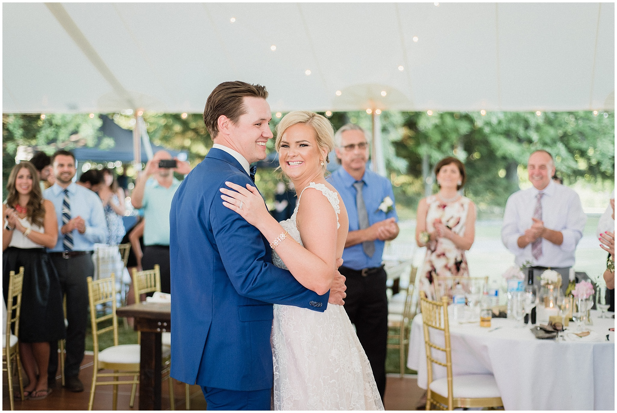 Bride and groom's first dance under string lights | Tent wedding in Guelph, Ontario by Jenn Kavanagh Photography