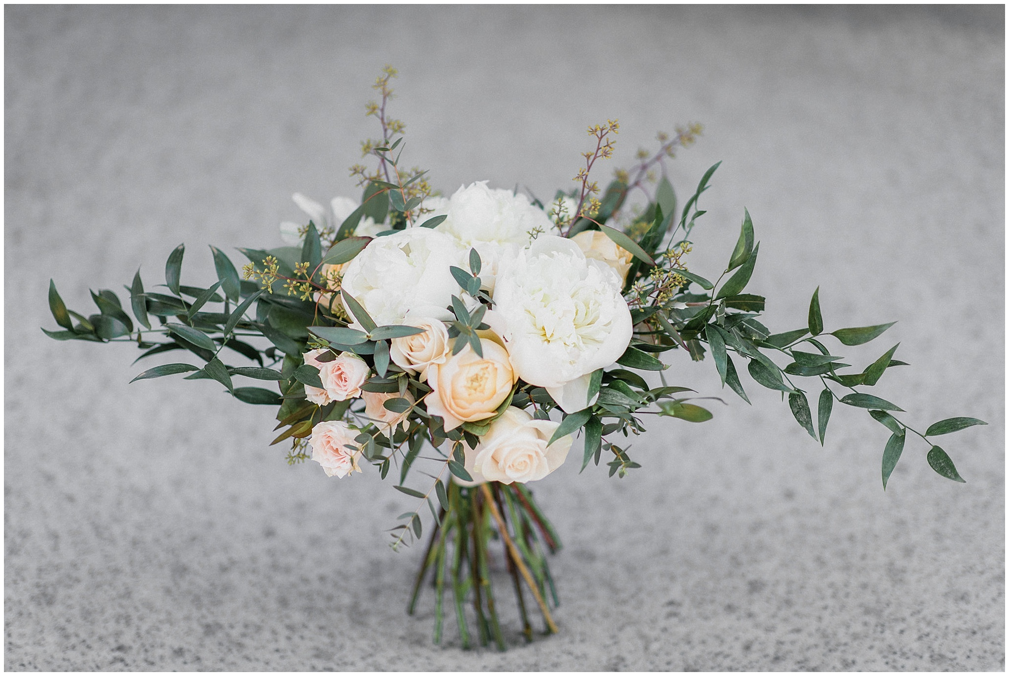 Hand tied rustic florals for the bride's bouquet | Tent wedding on family farm in Guelph, Ontario by Jenn Kavanagh Photography