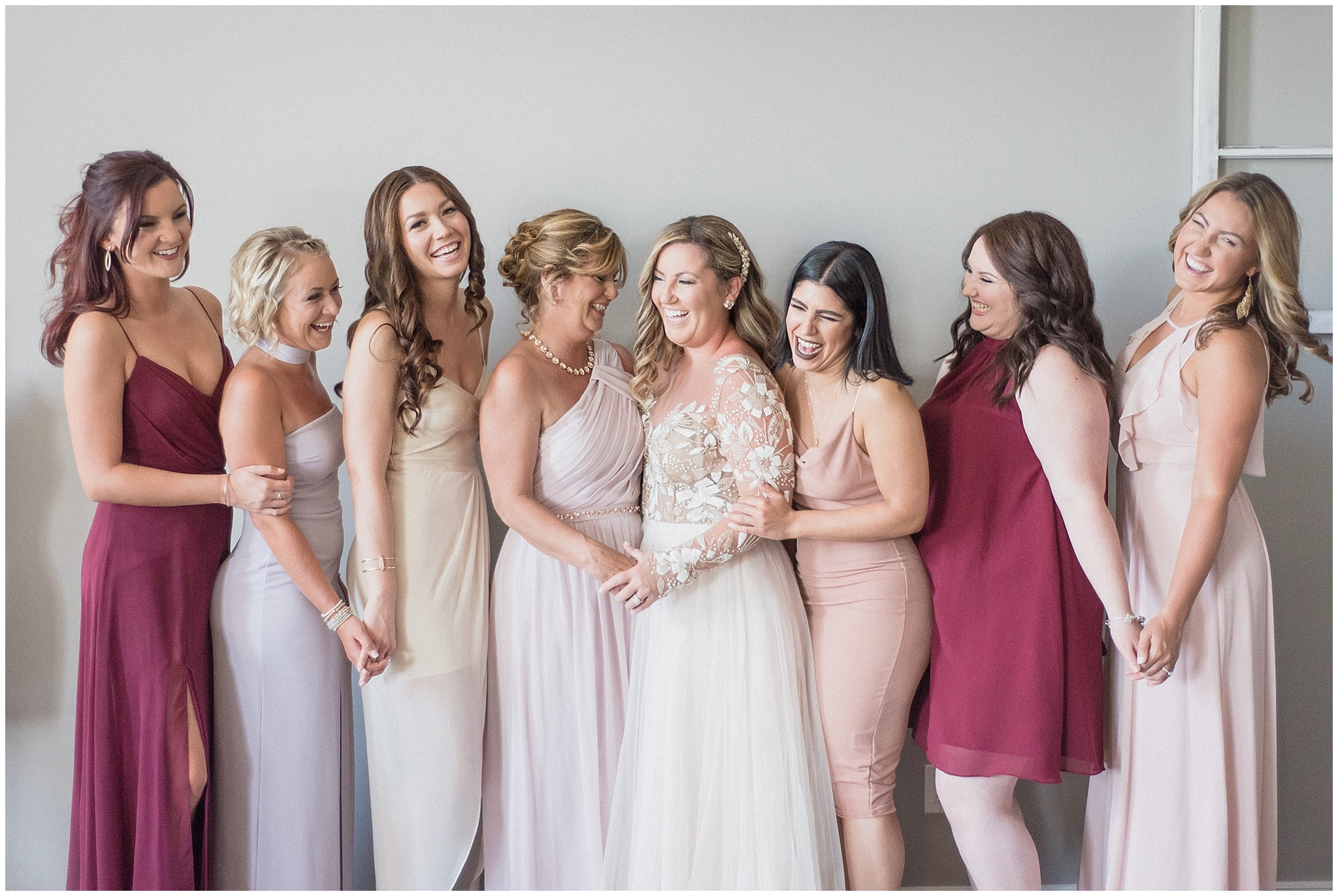 Mismatched blush, nude and wine bridesmaids photographed by Jenn Kavanagh Photography