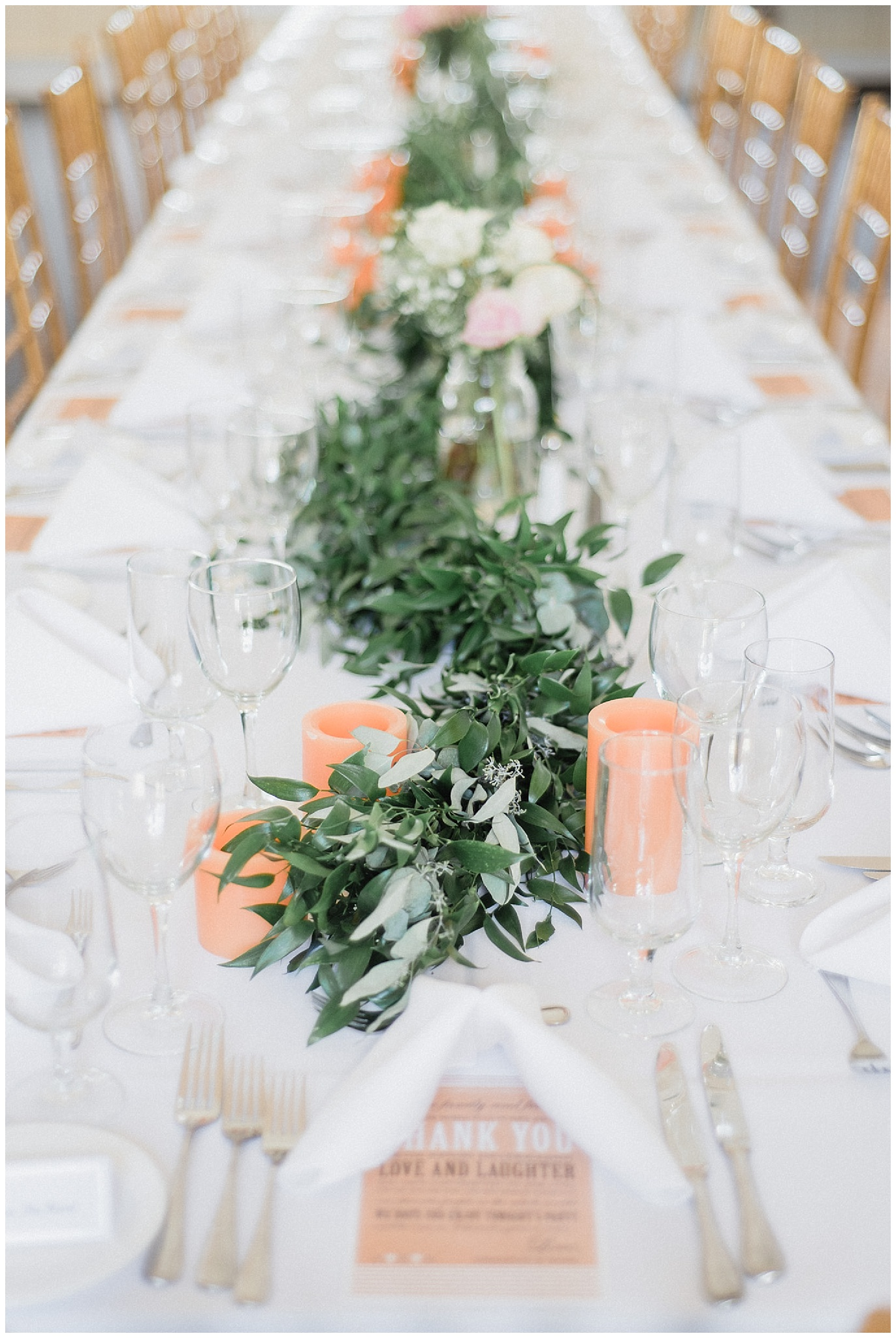 Rustic reception decor with garland and greenery at Tralee Wedding Facility, photographed by Jenn Kavanagh Photography