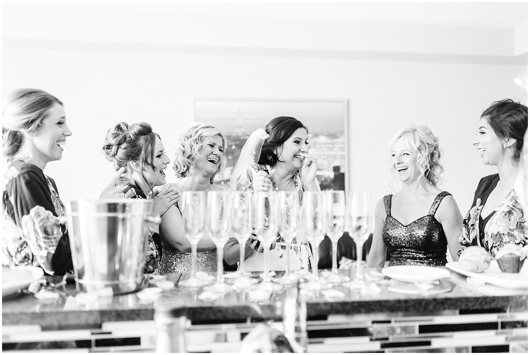 Bride and bridesmaids popping champagne by Jenn Kavanagh Photography