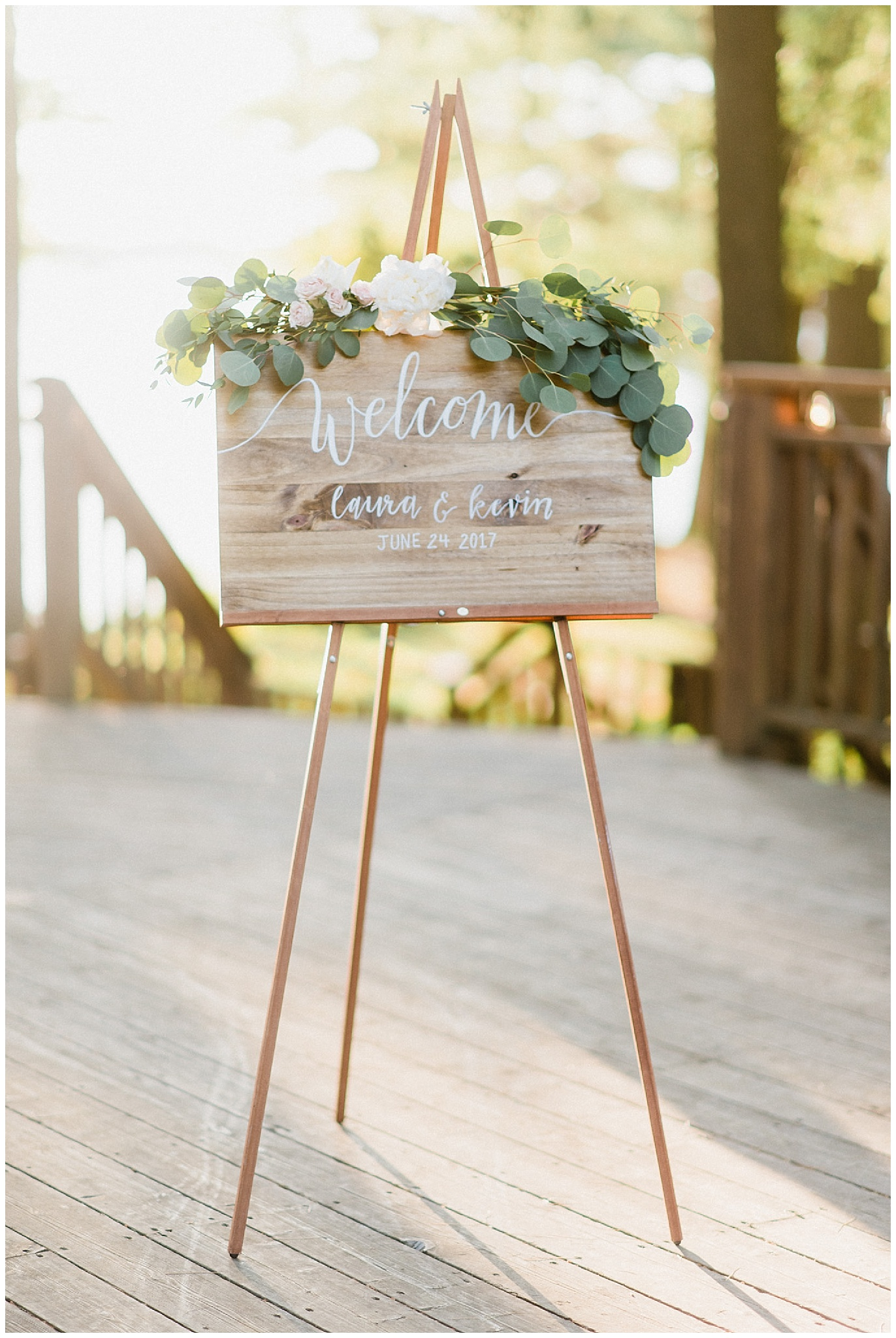Calligraphy welcome sign with florals and garland by Jenn Kavanagh Photography