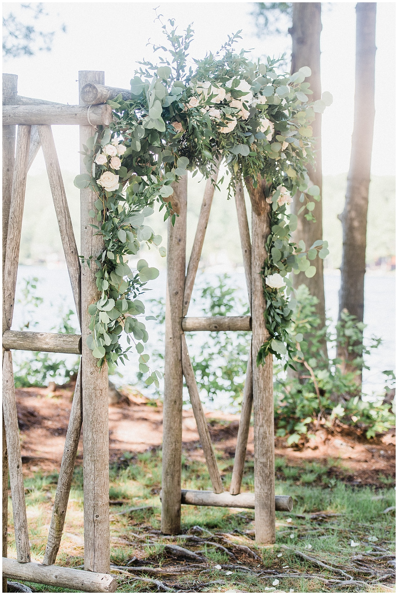Floral arch for an elegant Muskoka wedding by Jenn Kavanagh Photography