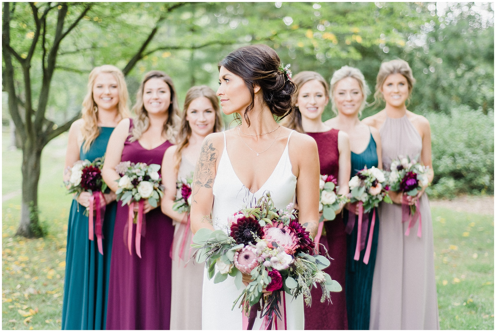 Burgundy, forest green and taupe bridesmaids | Victoria Park Pavilion photographed by Jenn Kavanagh Photography
