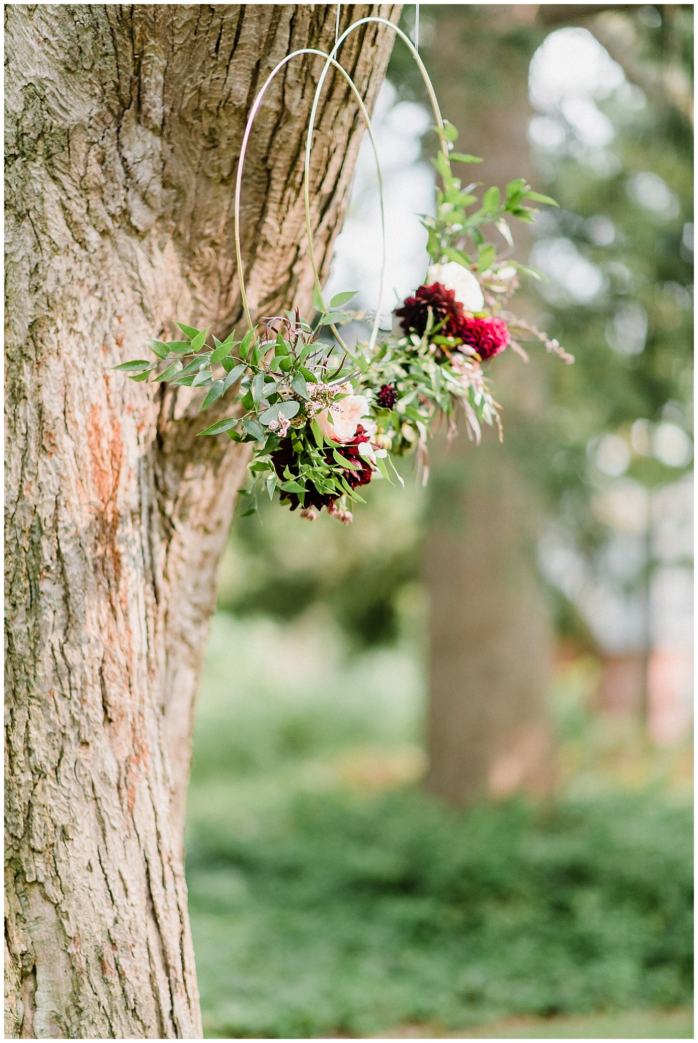 Floral hoop ceremony decor by Mint and Magnolia, photographed by Jenn Kavanagh Photography