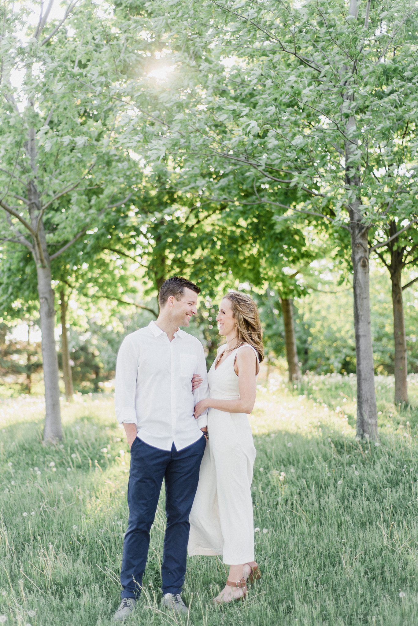 Gorgeous bride-to-be in elegant white jumpsuit, photographed by Jenn Kavanagh Photography.