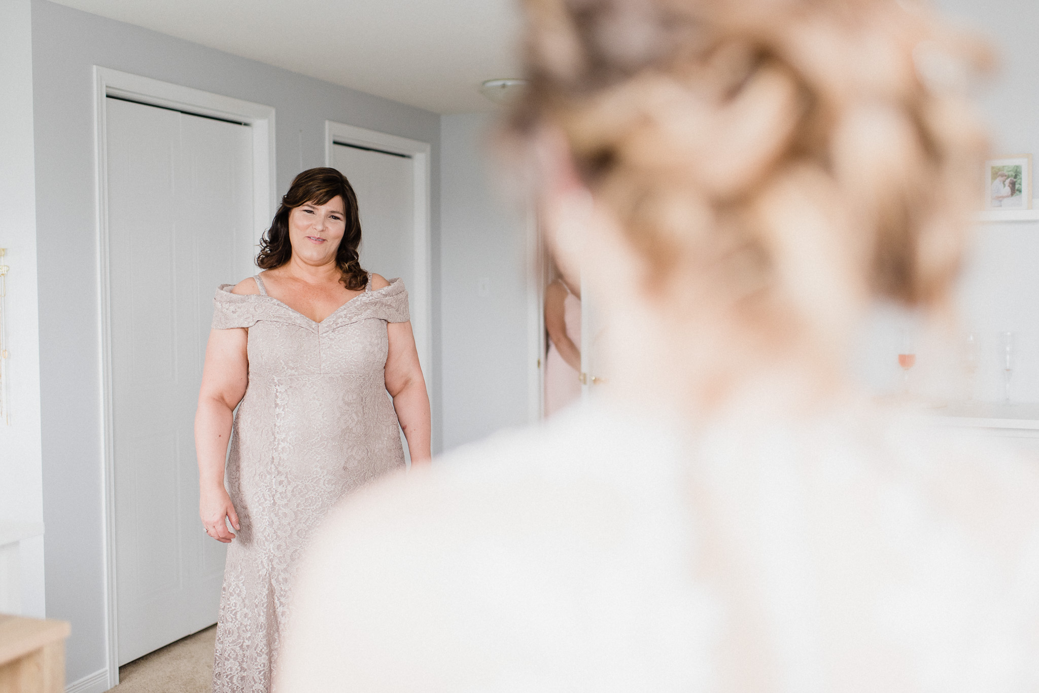 First look with Mom and Bride photographed by Jenn Kavanagh Photography
