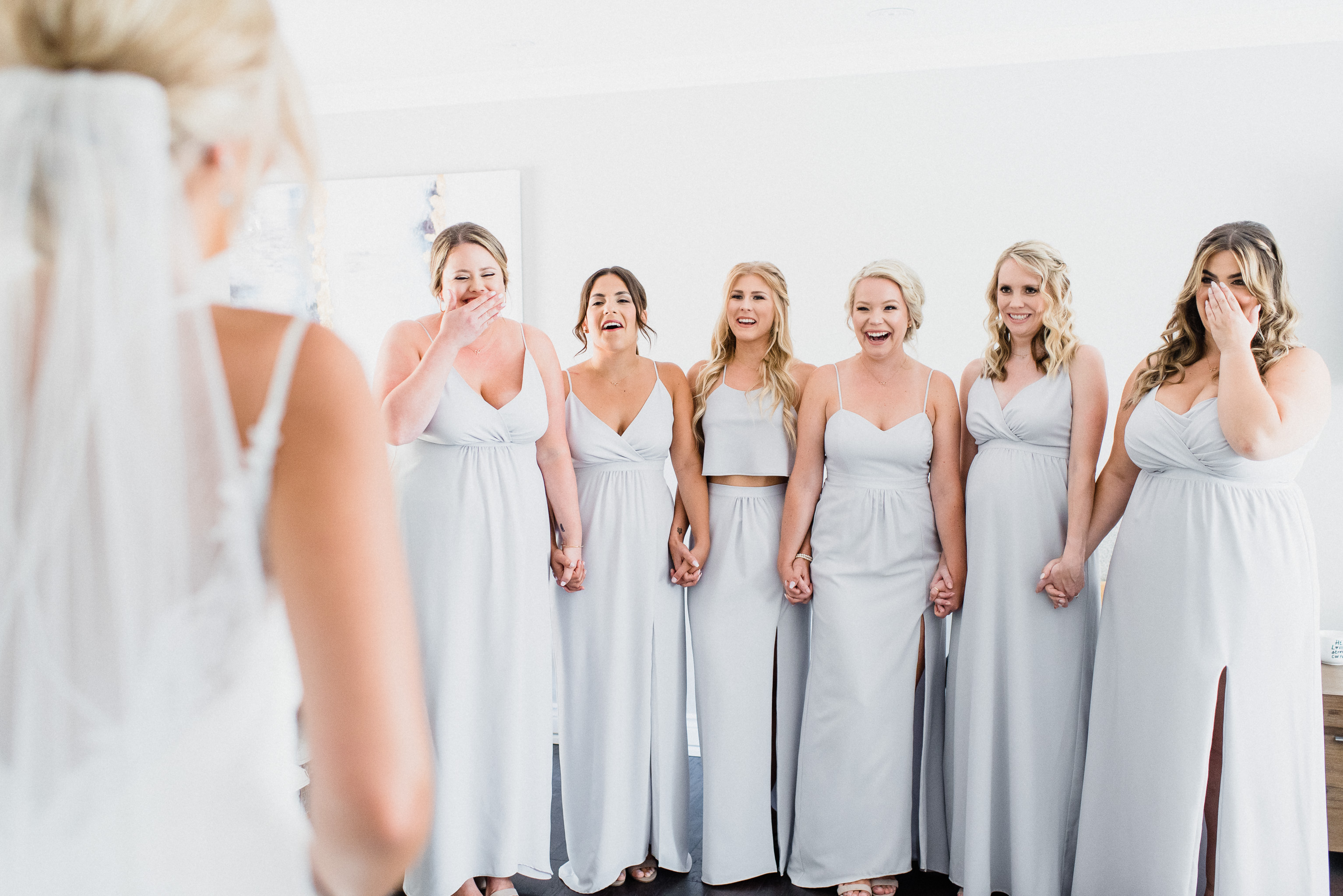 Bride's first look with bridesmaids by Jenn Kavanagh Photography