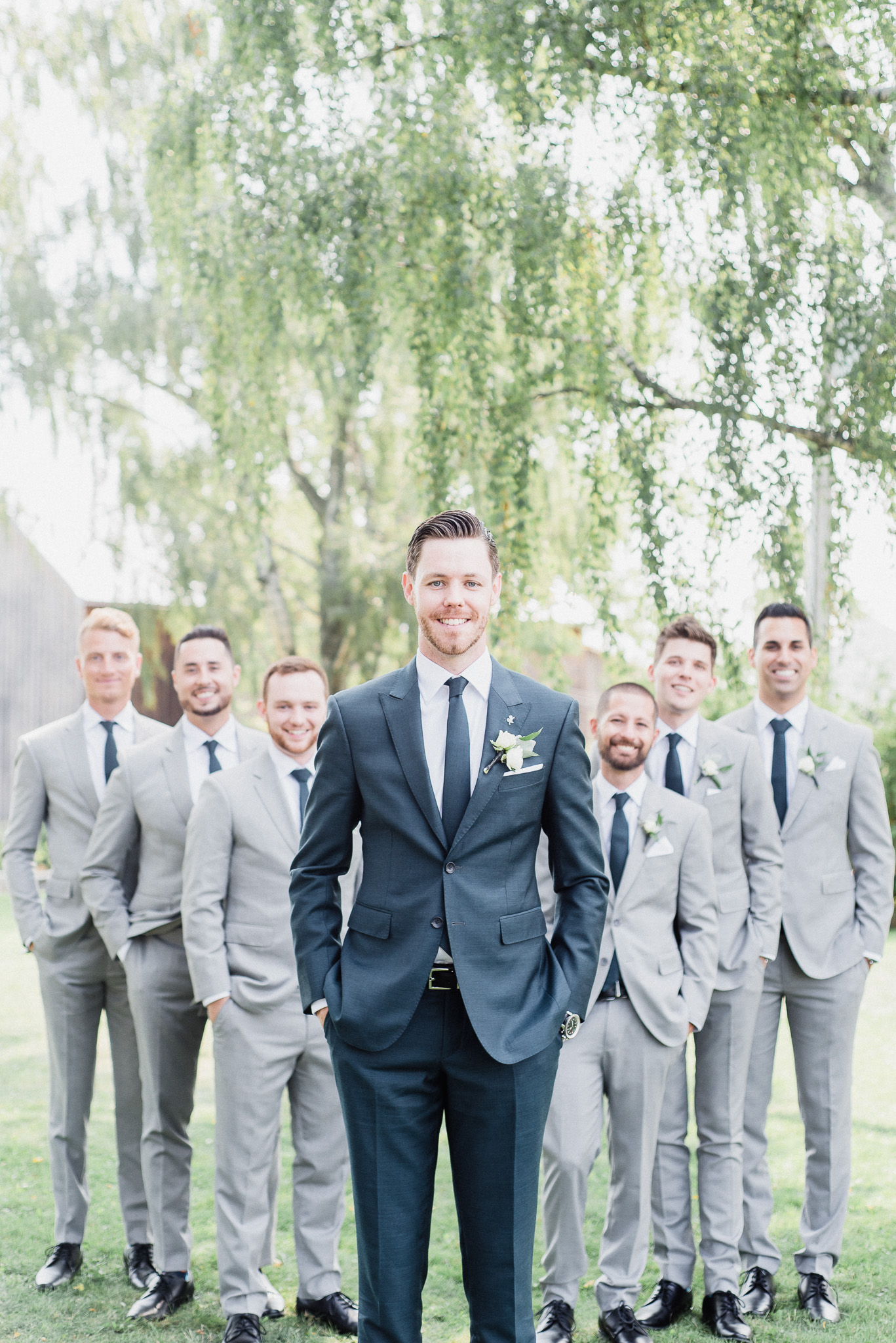 Mismatched groom and groomsmen suits by Jenn Kavanagh Photography