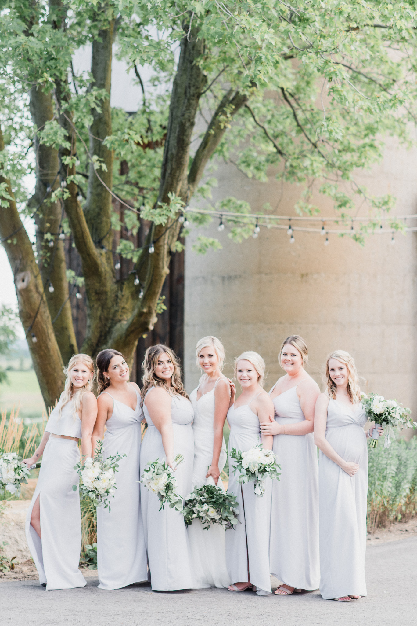 Bridesmaids in 'Dove Drey' Park & Fifth Co dresses by Jenn Kavanagh Photography