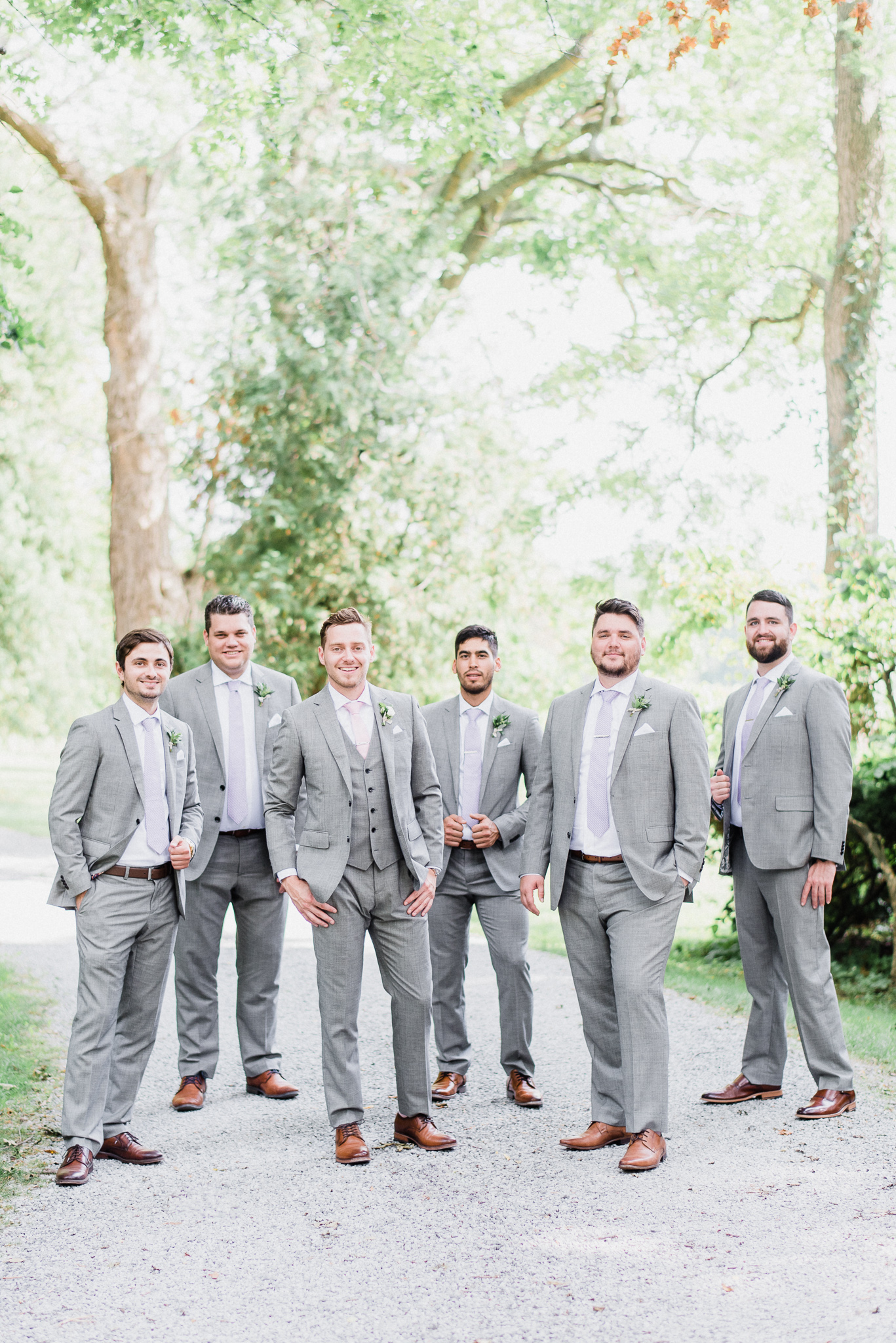 Light grey Indochino groom and groomsmen suits by Jenn Kavanagh Photography