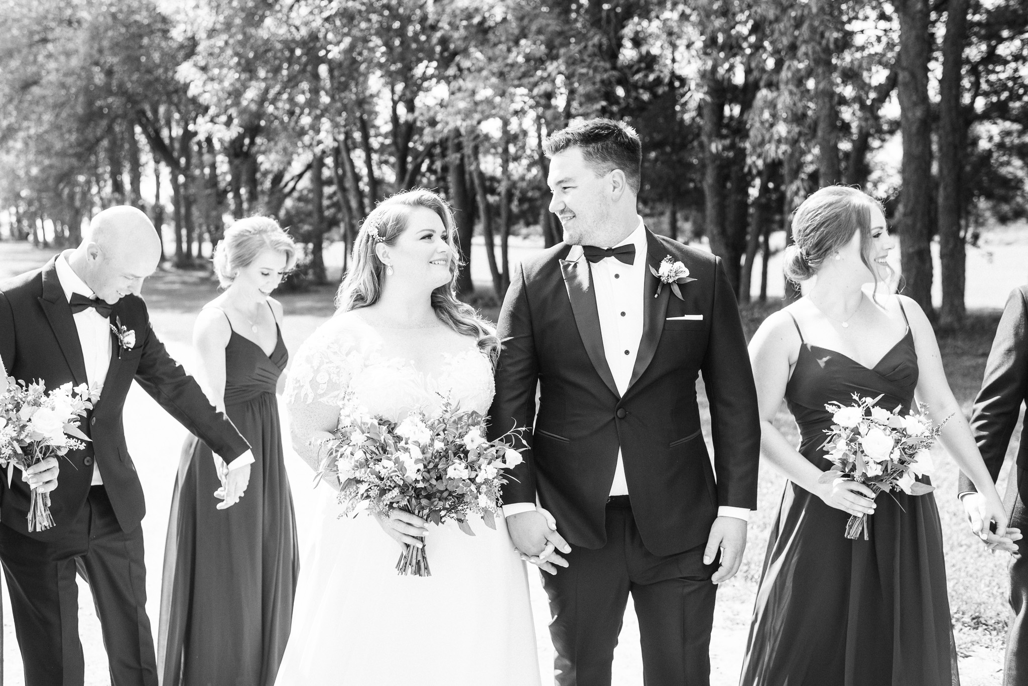 Groom in fitted black tux by Jenn Kavanagh Photography