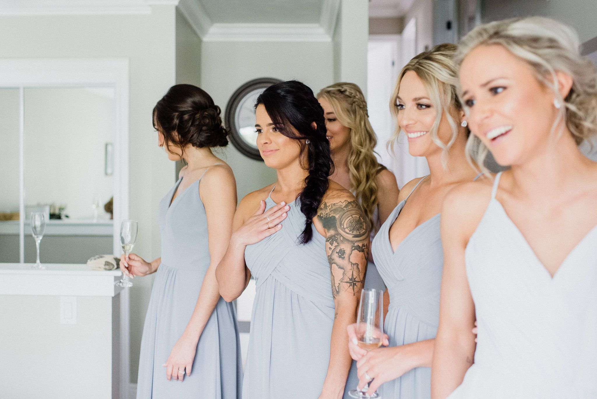 Mismatched grey and blue bridesmaids dresses by Jenn Kavanagh Photography