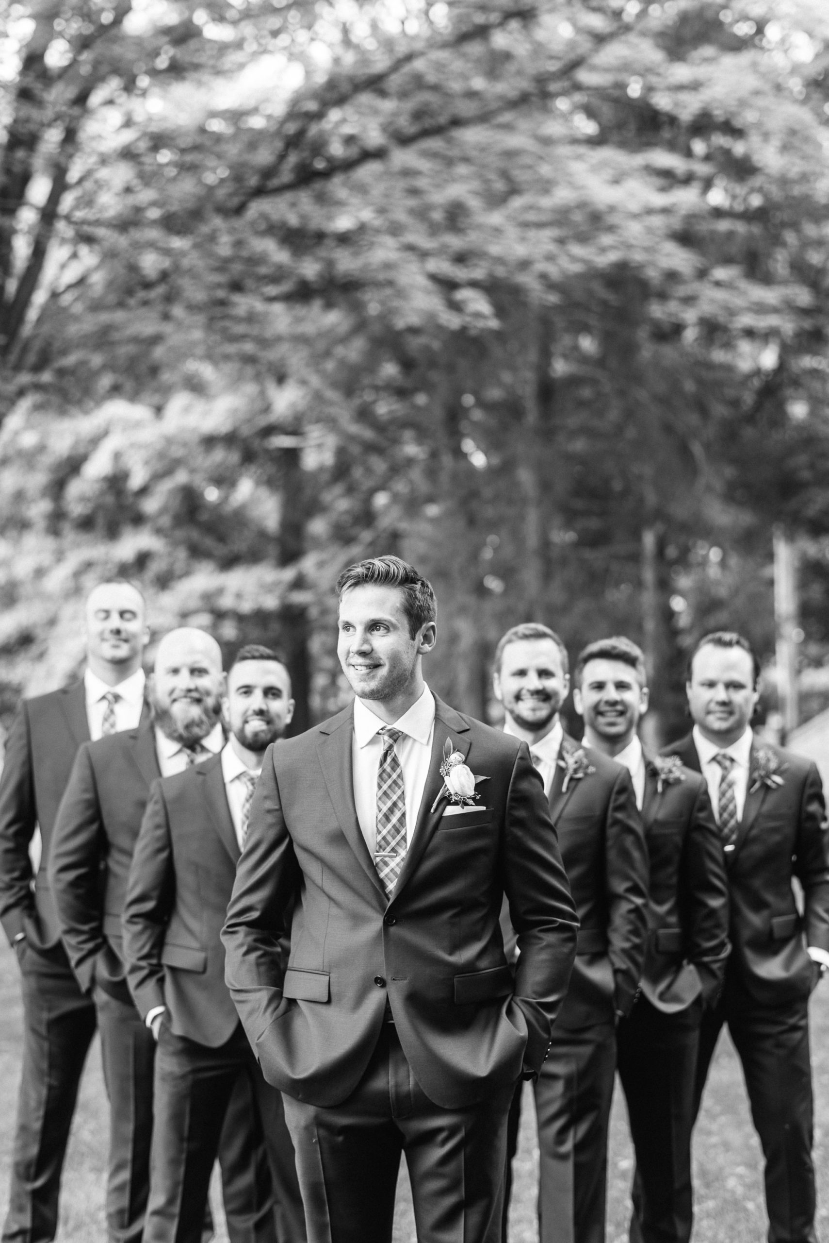 Groom and groomsmen in navy suits by Jenn Kavanagh Photography