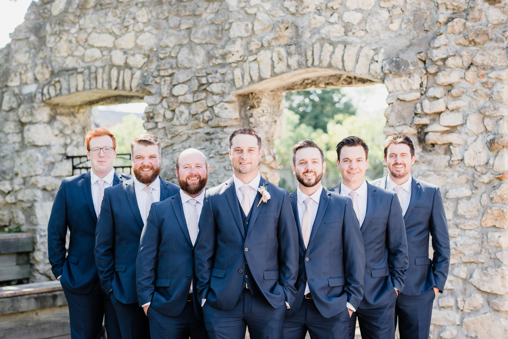 Groom and groomsmen in navy blue suits by Jenn Kavanagh Photography