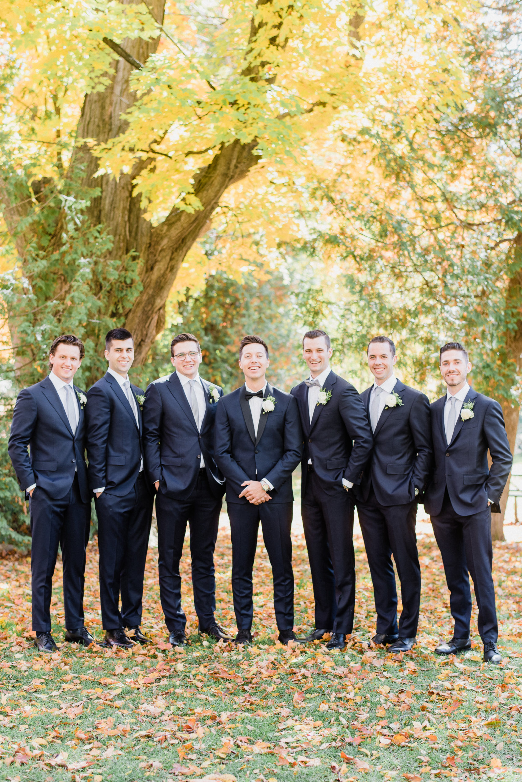 Groom and groomsmen in navy blue tuxes by Jenn Kavanagh Photography